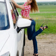 The beautiful girl stands near to white car — Stok fotoğraf