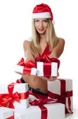 Christmas girl with boxes of gifts — Stock Photo