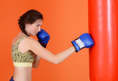 The woman with a boxing pear — Stock Photo