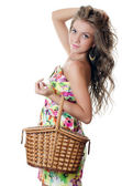The beautiful girl with a basket — Stok fotoğraf