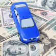 The toy car for dollar banknotes as a background — Stock Photo