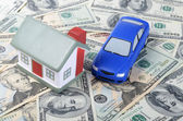 Toy house for dollar banknotes as a background — Stock Photo