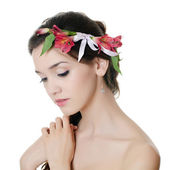 Portrait of the beautiful girl with flowers in hair — Stock Photo