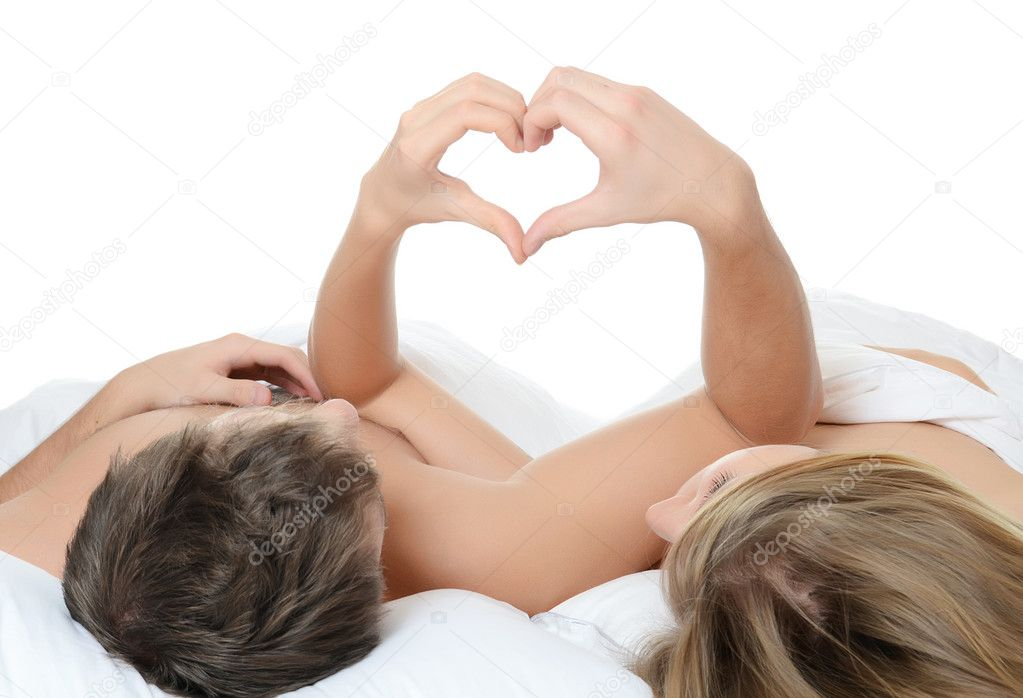 Beautiful pair lays in a bed stock photo voronin 76 for Sexy bed photos