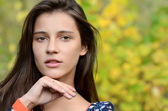 Portrait of the young girl with autumn foliage — Stock Photo