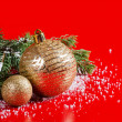 The christmas tree ball in snow - Stock Photo