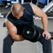 Royalty-Free Stock Photo: Man with dumbbells in sports club