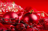 New Year's spheres on red fabric — Stock Photo