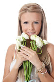 Girl with white flower — Stock Photo