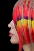 The beautiful girl with a bright make-up and multi-coloured strand in hair — Stock Photo