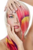 The beautiful girl with a bright make-up and multi-coloured stra — Stock Photo