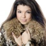 Beautiful girl in a fur hood — Stock Photo #18704841