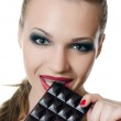 The girl with chocolate bar isolated — Stock Photo #18704977