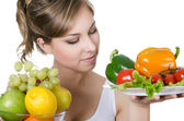 Beautiful girl with fruit and vegetables — Stock Photo