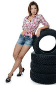 The girl with automobile tyres — Stock Photo