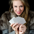 Stock Photo: Beautiful girl with playing card