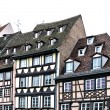 Traditional half-timbered houses street in Strasbourg, Alsace, France - Stock Photo