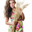 Royalty-Free Stock Photo: The beautiful girl with wheat ears
