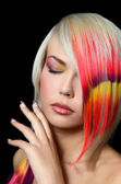 The beautiful girl with a bright make-up and multi-coloured strand in hair — Стоковое фото