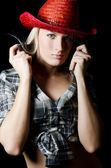 The beautiful girl in a cowboy's hat isolated — Stock Photo