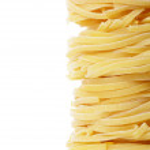 Italian pasta tagliatelle nest isolated on white background — Stock Photo #19990051
