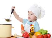 Le petit garçon dans un chapeau du cuisinier — Photo