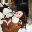 Stock Photo: Womwith dog Husky in winter