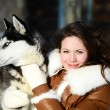 The woman with a dog Husky in the winter — Photo