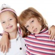 Stock Photo: Two young girl friends on white background