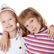 Two young girl friends on white background — Stock Photo