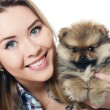 Постер, плакат: The beautiful girl with a puppy spitz