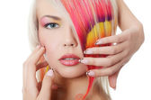 The beautiful girl with a bright make-up and multi-coloured strand in hair — Fotografia Stock
