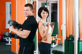The woman on a training apparatus in sports club — Stock Photo