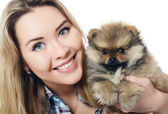 The beautiful girl with a puppy spitz — Stock Photo