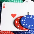 Two ases and casino chips - Stock Photo