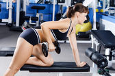 Woman with dumbbells in sports club — Stock Photo