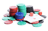 Double aces with big stack and dice over white — Stock Photo