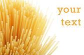 Uncooked pasta spaghetti macaroni isolated on white background — Stock Photo