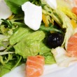 Royalty-Free Stock Photo: Salad with salmon and mascarpone cheese, pomelo leaves and lettuce. The restaurant dish