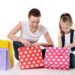 Mom and daughter with lot packages with shopping — Stok fotoğraf