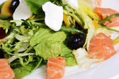 Salad with salmon and mascarpone cheese, pomelo leaves and lettuce. The restaurant dish — Стоковое фото