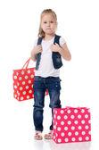 A menina com dois pacotes isolados — Fotografia Stock
