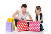 Mom and daughter with lot packages with shopping — Stock Photo