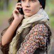 The girl speaks by phone in the autumn — Stock Photo