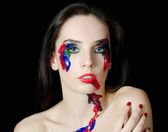 The beautiful woman with a paint on the face — Stock Photo