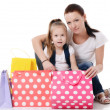 Mom and daughter with lot packages with shopping — Stock Photo #24434081