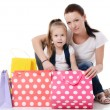 Mom and daughter with lot packages with shopping - Stock Photo