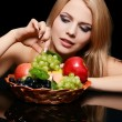 The beautiful woman with basket of fruit — Stock Photo