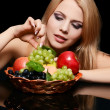 The beautiful woman with basket of fruit — Stockfoto