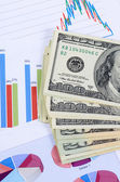 Banknotes of dollar with chart — Stock Photo